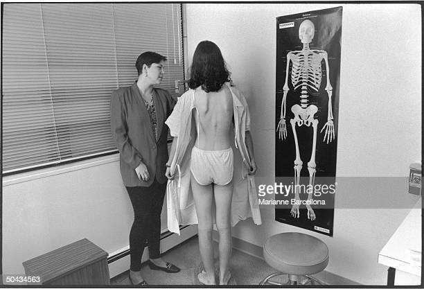 Registered Nurse dietitian counselor Suzanne Henrick weighs 16 yearold female anorexia nervosa patient in an openbacked hospital gown at the Wilkins...