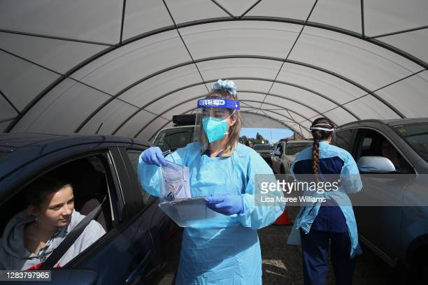 Registered Nurse Ellie Taylor conducts a COVID-19 test at the Bondi Beach testing clinic on November 04, 2020 in Sydney, Australia. The COVID-19...