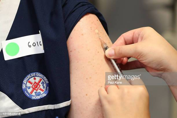 Registered nurse Heather Hoppe receives a BCG injection in the trial clinic at Sir Charles Gairdner hospital on April 20 2020 in Perth Australia...