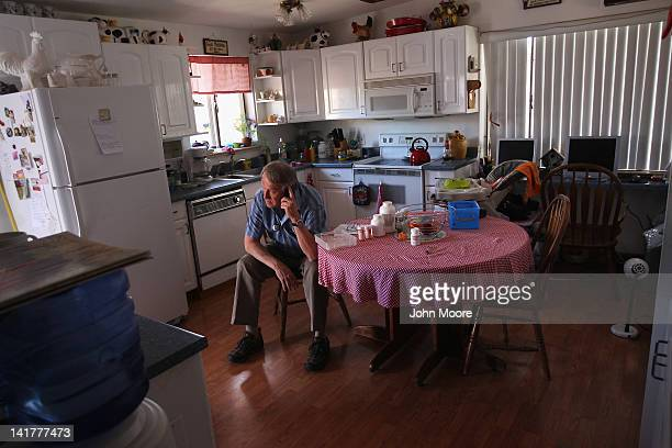 Registered nurse Steve Van Dyke calls in a prescription to a pharmacy while paying a house call to a patient on March 23 2012 in Arvada Colorado The...