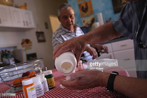 Registered nurse Steve Van Dyke sorts a patient's medication while on a home health care visit on March 23 2012 in Arvada Colorado The Supreme Court...