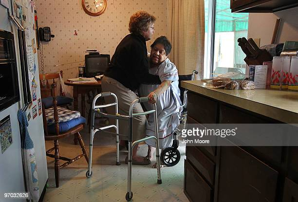 Registered nurse Susan Eager helps up Jane Awise who suffers from severe diabetes while performing a home health care visit on February 24 2010 in...