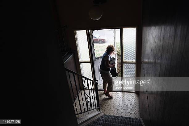 Registered nurse Susan Eager leaves after paying a house call to a patient on March 26 2012 in Lakewood Colorado The Supreme Court Monday began...