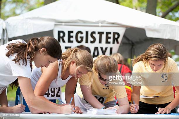registering for running race - salem massachusetts stock pictures, royalty-free photos & images