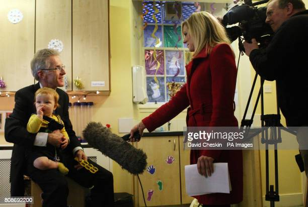 Registrar General for Scotland Duncan McNiven talks a TV interviewer as 10 month old Jack Morgan looks on at the Rutland nursery Edinburgh after...
