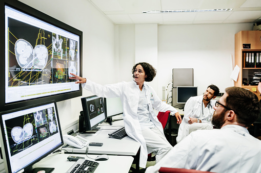 Registrar Reviewing Patient's Test Results With Doctors - gettyimageskorea