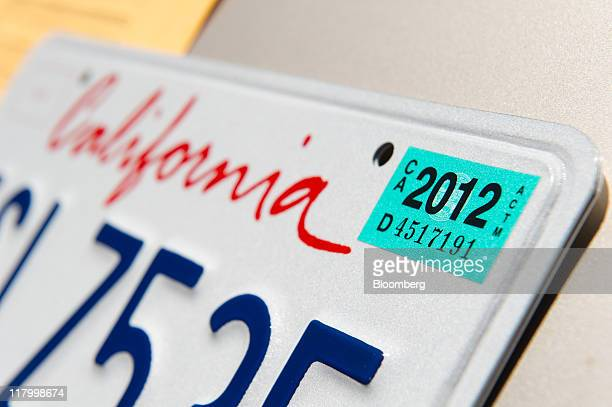 A 2012 registration sticker is displayed on a license plate at the Department of Motor Vehicles in Daly City California US on Friday July 1 2011...