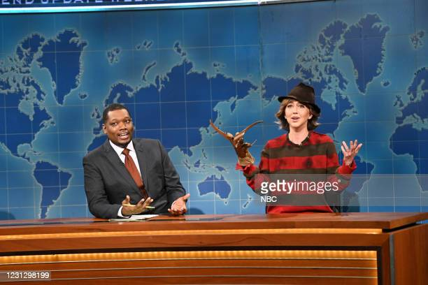 """Regé-Jean Page"""" Episode 1798 -- Pictured: Anchor Michael Che and Heidi Gardner as Jessie Rauch during Weekend Update on Saturday, February 20, 2021 --"""