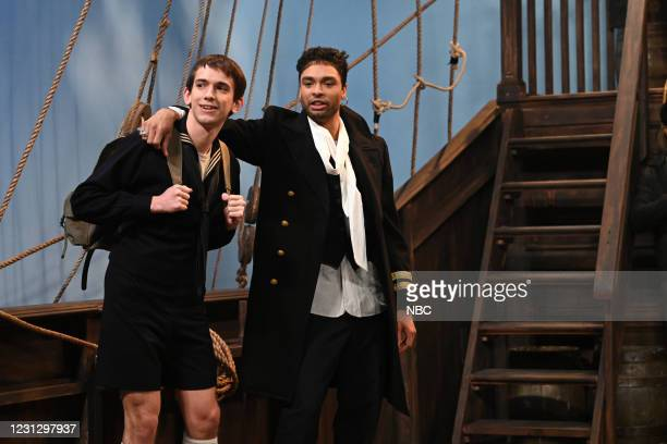 """Regé-Jean Page"""" Episode 1798 -- Pictured: Andrew Dismukes and host Regé-Jean Page during the """"Sea Shanty"""" sketch on Saturday, February 20, 2021 --"""