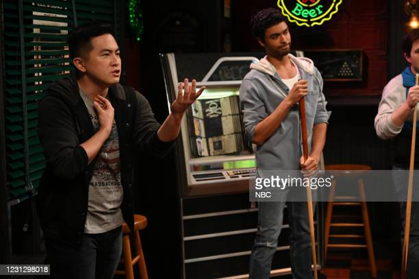 """Regé-Jean Page"""" Episode 1798 -- Pictured: Bowen Yang and host Regé-Jean Page during the """"Pool Hall"""" sketch on Saturday, February 20, 2021 --"""