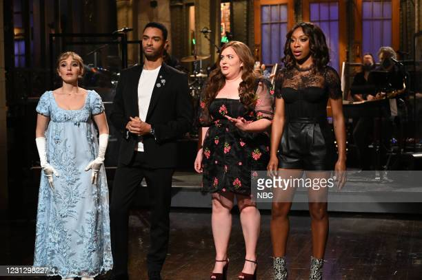 """Regé-Jean Page"""" Episode 1798 -- Pictured: Chloe Fineman as Daphne, host Regé-Jean Page, Aidy Bryant, and Ego Nwodim during the Monologue on Saturday,..."""