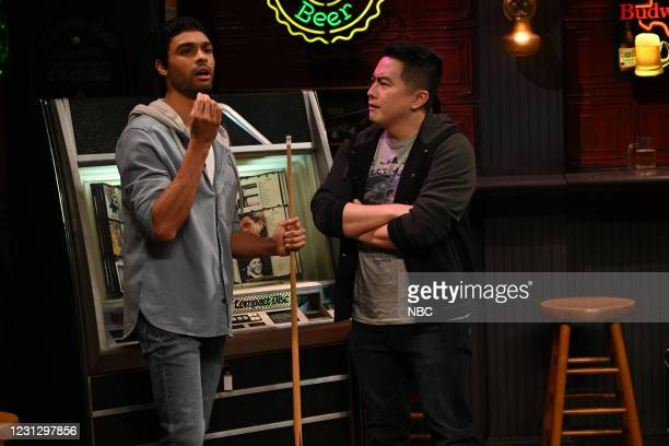 """Regé-Jean Page"""" Episode 1798 -- Pictured: Host Regé-Jean Page and Bowen Yang during the """"Pool Hall"""" sketch on Saturday, February 20, 2021 --"""