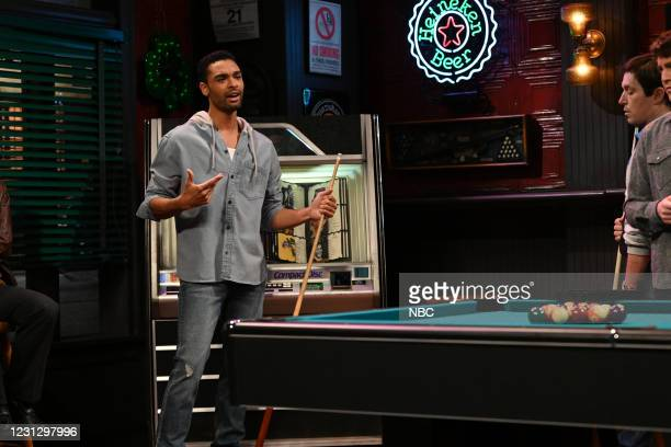 """Regé-Jean Page"""" Episode 1798 -- Pictured: Host Regé-Jean Page during the """"Pool Hall"""" sketch on Saturday, February 20, 2021 --"""