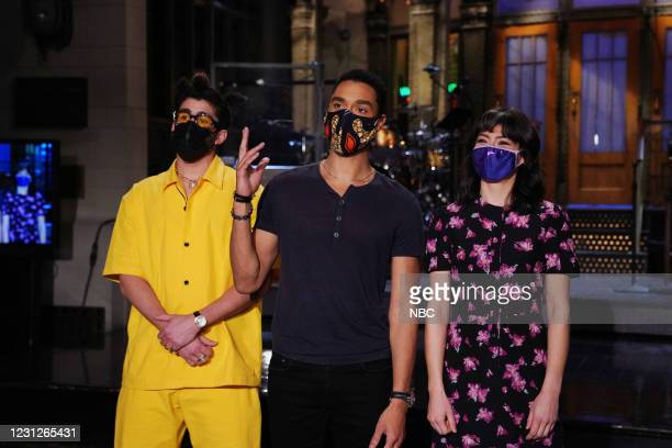 """Regé-Jean Page"""" Episode 1798 -- Pictured: Musical guest Bad Bunny, host Regé-Jean Page, and Melissa Villaseñor during Promos in Studio 8H on..."""