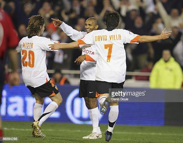 Regueiro of Valencia celebrates with David Villa and Mista after scoring a goal during a Primera Liga match between Valencia and Osasuna at the...