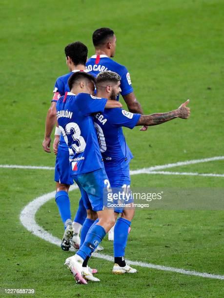 Reguilon of Sevilla FC Ever Banega of Sevilla FC celebrates goal 11 during the La Liga Santander match between Athletic de Bilbao v Sevilla at the...