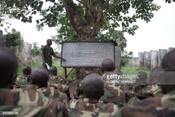 TOPSHOT A regular army instructor teaches military tactics at Kassai camp to former militiamen demobilized from armed groups in Bangui on March 14...