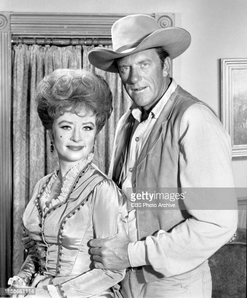 Regular cast members from the CBS television Western series Gunsmoke. July 22, 1965. Pictured from left is Amanda Blake , James Arness .