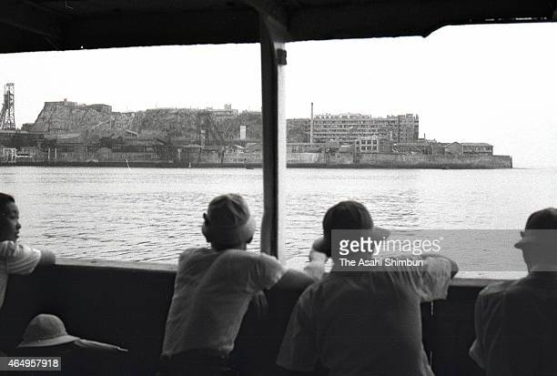 Regular ferry approaches to Hashima on August 12, 1956 in Takashima, Nagasaki, Japan. The coal mining island, is also known as the Battleship Island,...