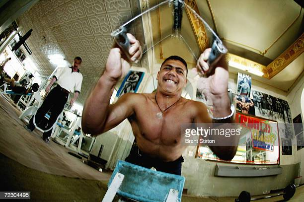 A regular member supervised by national coach Hamid Abd AlRahman worksout at the Arnold Classic Gym May 16 2004 in Baghdad Iraq The Arnold Classic...