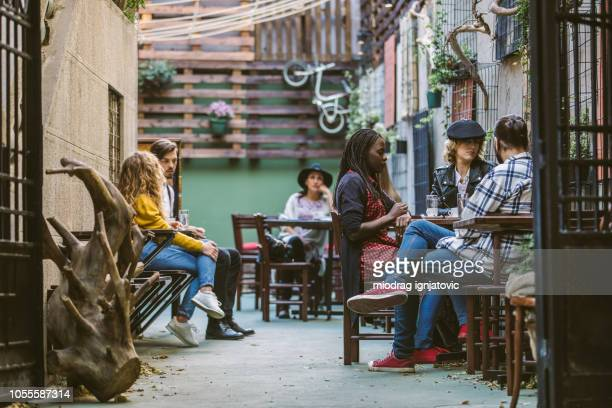 regular morning at sunny sidewalk cafe - artisan stock photos and pictures