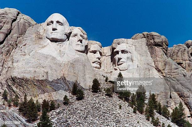 CONTENT] A regular shot of Mount Rushmore on film The four presidents carved into the mountain can be seen on a clear crisp summer day