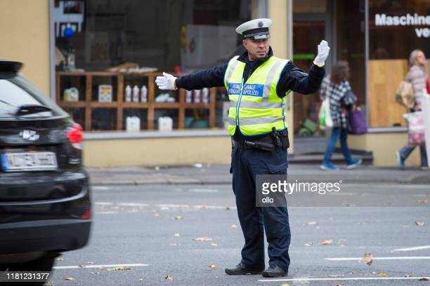 regulating the traffic - traffic cop stock pictures, royalty-free photos & images