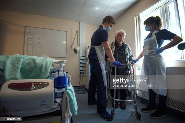 Rehab Support Workers perform a physiotherapy treatment on patient Michael Kidd as the first patients are admitted to the NHS Seacole Centre at...