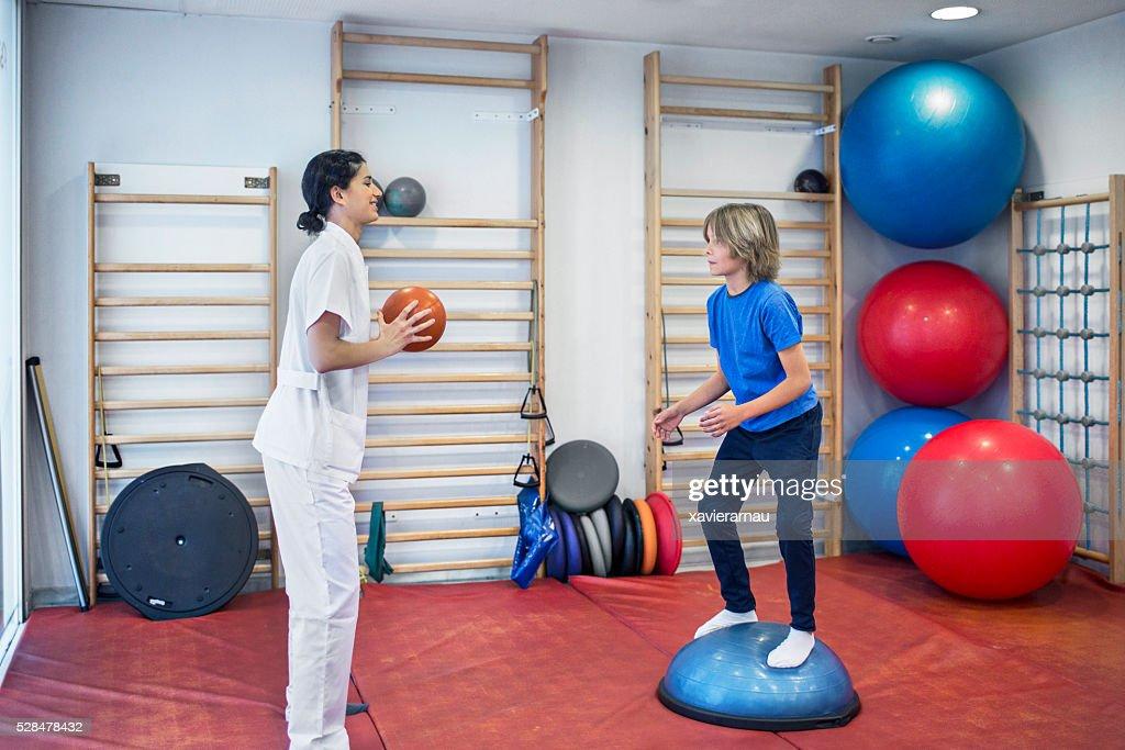 Rehabilitation exercises with ball : Stock Photo