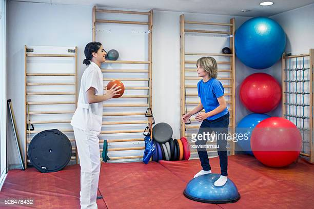 rehabilitation exercises with ball - big bums stock photos and pictures