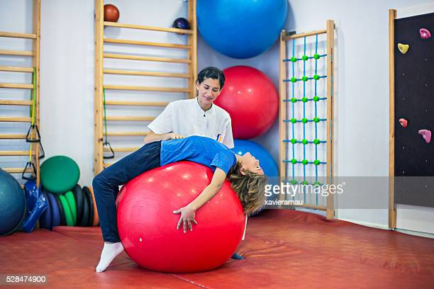rehabilitation with large ball - big bums stock photos and pictures