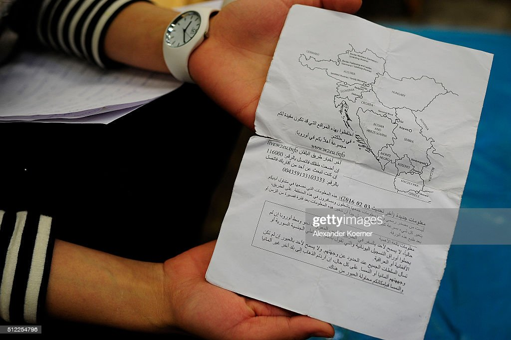 Reham Amairy from Bagdad, Iraq, shows a guide on how to travel to Germany, given by volunteers, after arriving at the shores of the Island of Lesbos, at a shelter where they live while their asylum applications are processed on February 25, 2016 in Sarstedt, Germany. Germany received approximately 1.1 million newcomers in 2015 and is now facing the arduous task of processing asylum claims and taking steps to integrate those whose applications are accepted.