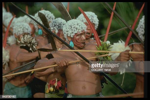 annual ceremony for the dead The warriors parade in their finery making guttural cries to honor the memory of the dead At dawn the whole tribe eats...