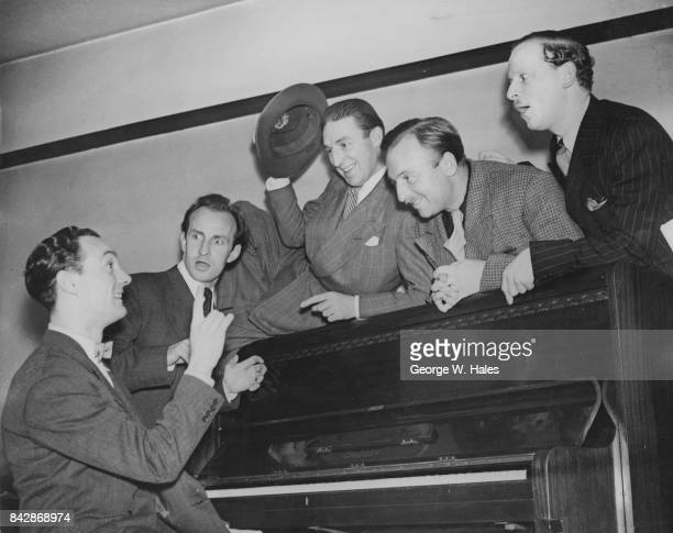 A rehearsal for 'Murdering a Song at the Piano' a segment of the radio comedy show 'Stand Easy' UK 4th October 1946 From left to right Ken Morris at...