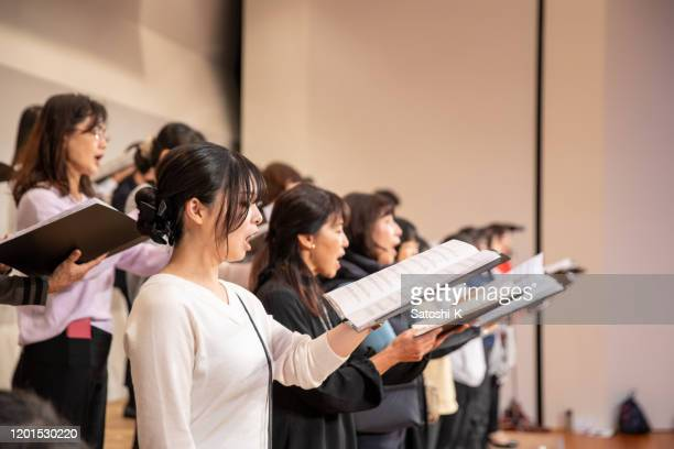 rehearsal of women's chorus concert - choir stock pictures, royalty-free photos & images