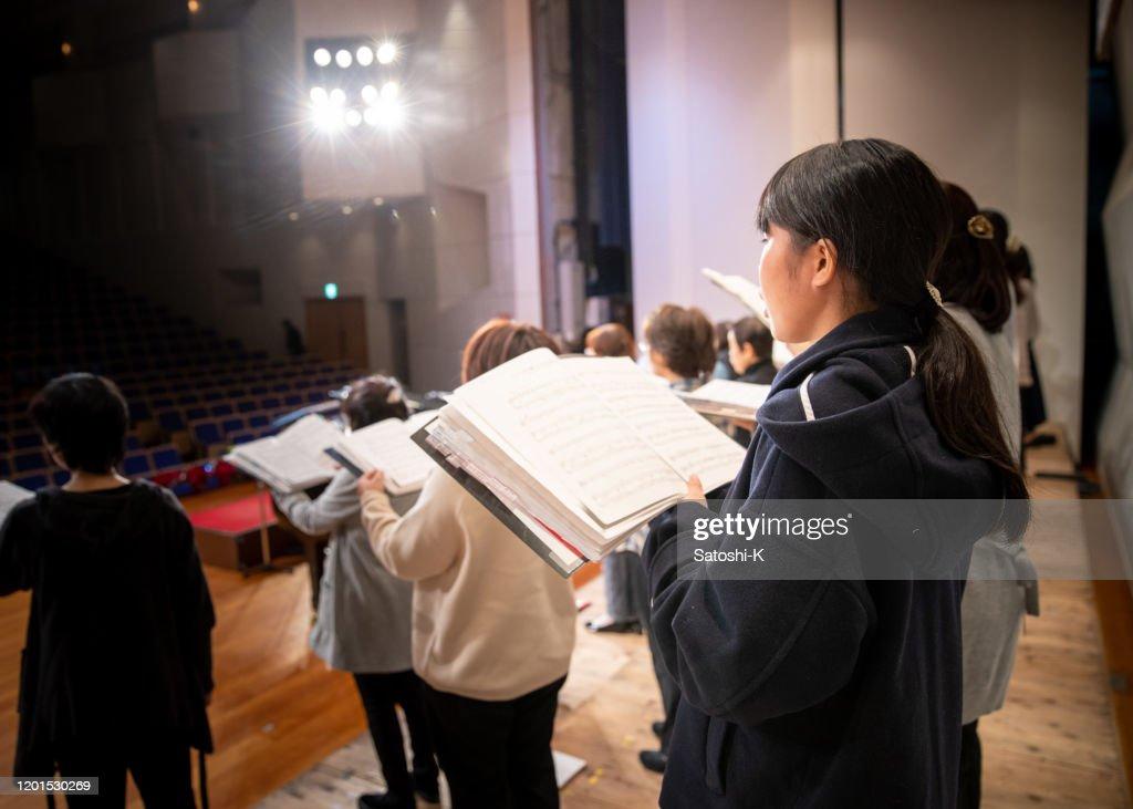 Rehearsal of women's chorus concert : Stock Photo