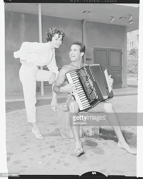 Rehearsal on Ice. Air conditioning equipment broke down in the studio in which accordionist Dick Contino was rehearsing yesterday, so Dick beat the...
