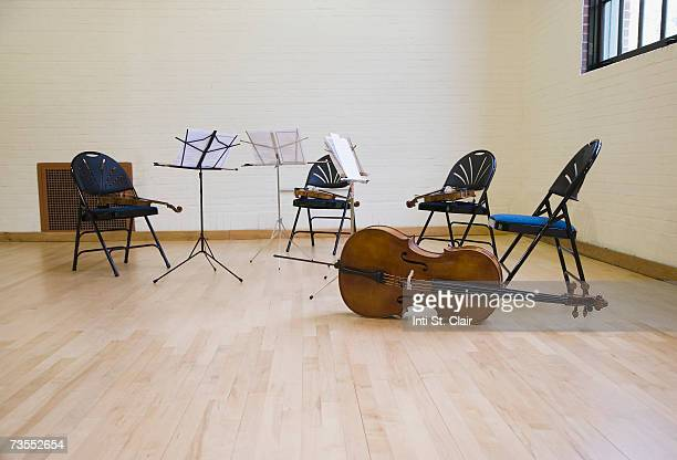 Rehearsal studio with music stand and musical instruments