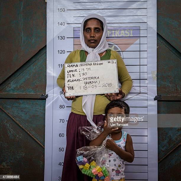 Rehena Begum a Rohingya migrant woman poses for identification purposes at a temporary shelter on May 18 2015 in Kuala Langsa Aceh province Indonesia...