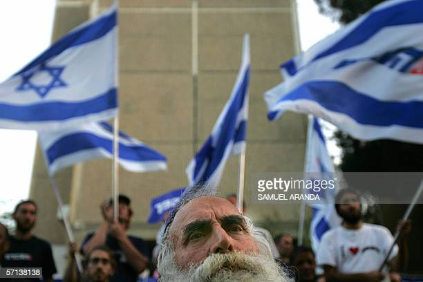 Israeli flags are flown by supporters as Labour party leader Amir Peretz speaks during his election campaign tour in the southern Israeli town of...