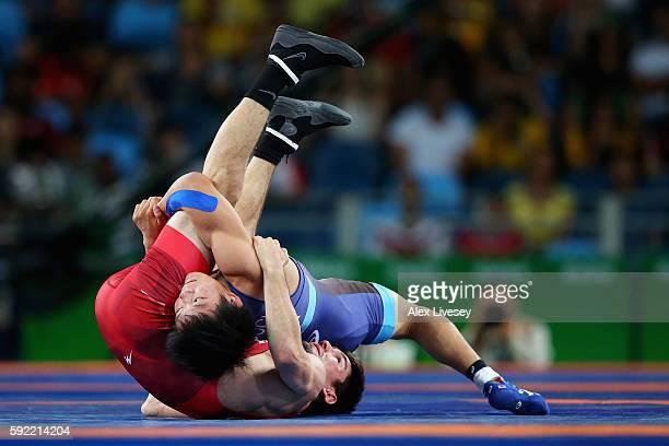 Rei Higuchi of Japan competes against Vladimer Khinchegashvili of Georgia during the Men's 57kg Gold Medal Wrestling match on Day 14 of the Rio 2016...