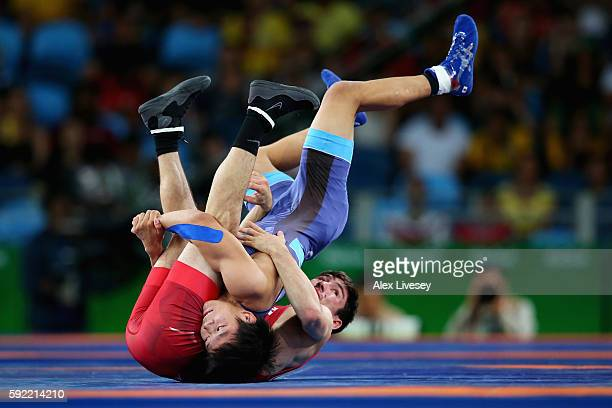 Rei Higuchi of Japan competes against Vladimer Khinchegashvili of Georgia during the Men's 57kg Gold Medal Wrestling match on Day 14 of the Rio 2016...