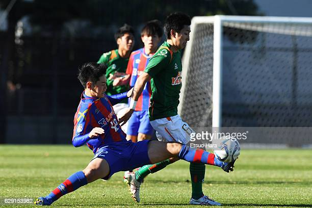 Rei Hirakawa#42 of FC Tokyo U18 and Kakeru Suminaga#6 of Aomori Yamada compete for the ball during the Prince Takamado Trophy U18 Premier League East...