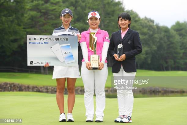 Rei Matsuda of Japan AhReum Hwang of South Korea and Minori Nagano of Japan pose with the trophy after the Karuizawa 72 Golf Tournament at the...