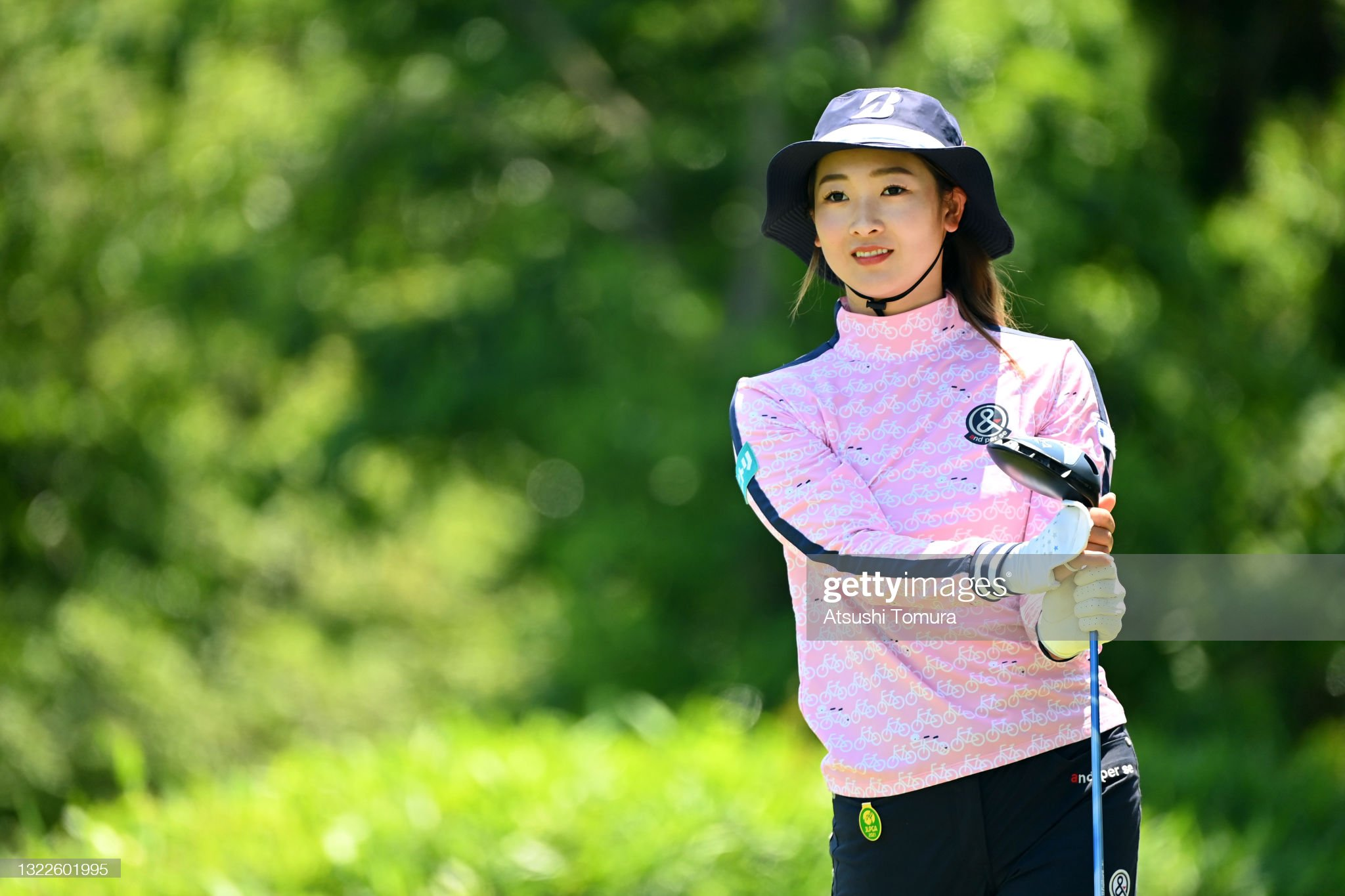 https://media.gettyimages.com/photos/rei-matsuda-of-japan-hits-her-tee-shot-on-the-14th-hole-during-the-picture-id1322601995?s=2048x2048