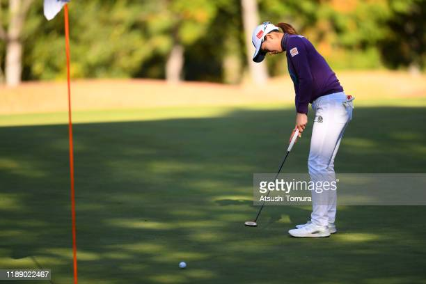Rei Matsuda of Japan holes the birdie putt on the 12th green during the first round of the Daio Paper Elleair Ladies at Elleair Golf Club Matsuyama...