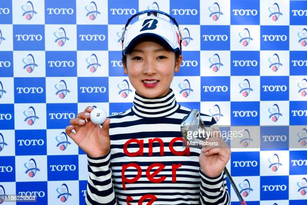 Rei Matsuda of Japan poses as she made a holeinone on the 9th hole after the first round of the TOTO Japan Classic at Seta Golf Course North Course...