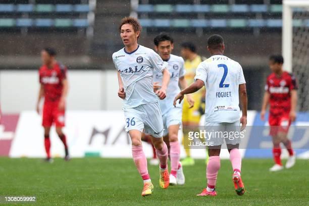 Rei Yonezawa of Kagoshima United celebrates scoring his side's second goal during the J.League Meiji Yasuda J3 match between Roasso Kumamoto and...