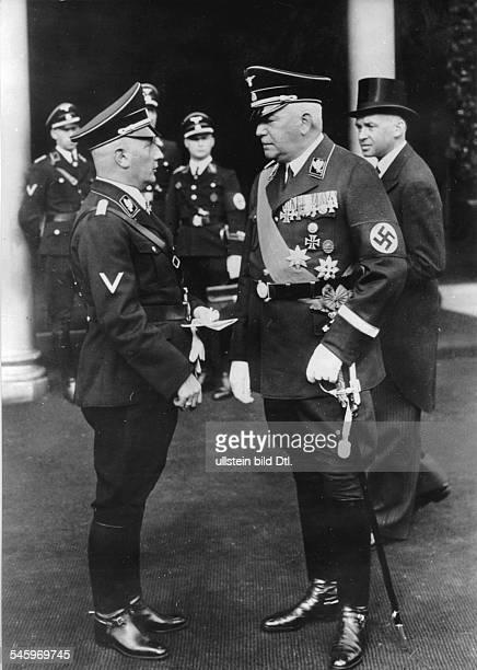 Reichsaussenminister Konstantin Frhr. V.Neurath vor dem Hauptbahnhofin Erwartung der Ankunft Benito Mussolinis