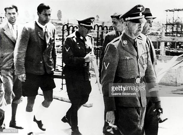 ReichsfuhrerSS Heinrich Himmler and Chief Engineer Max Faust during Himmler's visit to the MonowitzBuna plant at Auschwitz Poland July 1942
